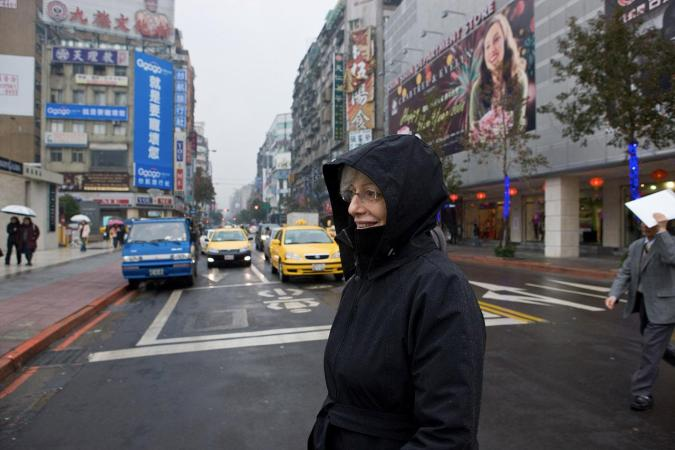 <strong>Tuesday, February 12, 3:15PM:</strong> A rainy day in Taipei does not dampen the spirits of Assistant Principal Viola Irene Breslaw as she heads back to the hotel following the Orchestra's rehearsal at the National Concert Hall.