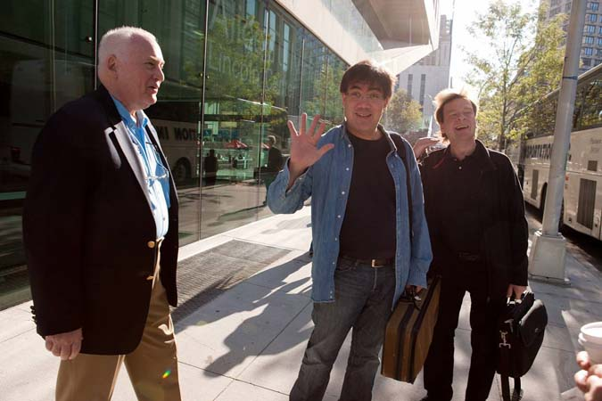 "<b>October 5, 2009, 9:40AM:</b> Departure! Music Director Alan Gilbert (center) stops by to wish the Philharmonic musicians ""bon voyage"" before they embark on their five-country Asian Horizons tour. Mr. Gilbert, who will catch up with them the next day, is flanked by Orchestra Personnel Manager Carl R. Schiebler (left) and Magnus Lindberg, the Orchestra's Marie-Josée Composer-in-Residence, whose <i>EXPO</i> is on the tour's first concert. <br><br> All photos by Chris Lee"