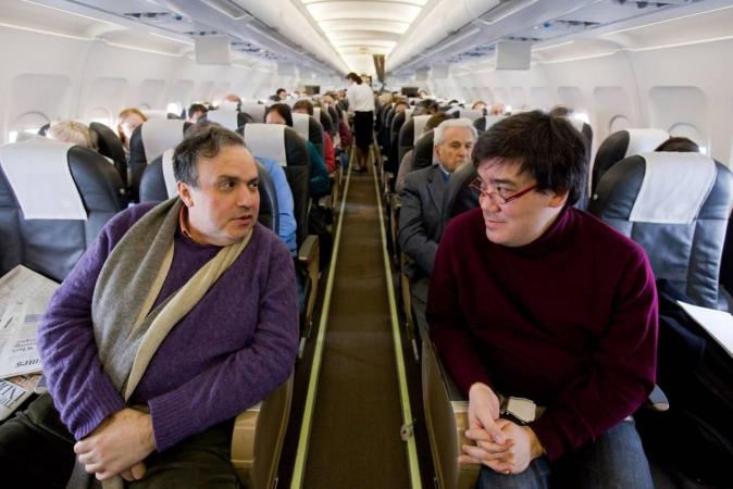 <b>Wednesday, January 27, 2010, 12:15PM:</b> The New York Philharmonic, led by Music Director Alan Gilbert (right), flies from Zurich to Frankfurt, Germany, the fifth city on the EUROPE / WINTER 2010 tour. With them is pianist Yefim Bronfman (left), who is performing with the Orchestra in seven of the thirteen concerts.<br><br>  All photos by Chris Lee
