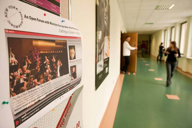 <b>Friday, October 29, 2010, 10:25AM:</b> A wall poster promotes a WebChat, organized by the United States Embassy in Poland, that is taking place on the New York Philharmonic's second day in Warsaw. Students throughout Poland will share in the discussion about a career in music given by two Orchestra musicians. <br><br> All photos by Chris Lee