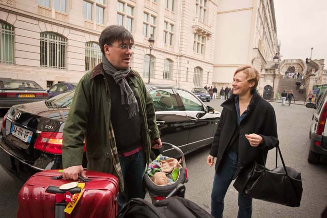 <b>Wednesday, November 3, 2010, 11:10AM:</b> The 24-hour stopover in Paris is over, and it's on to the final performances of the New York Philharmonic's EUROPE / AUTUMN 2010 tour. Here, with luggage and baby in hand, Music Director Alan Gilbert and his wife, Kajsa, depart for the train that will bring them to Luxembourg. <br><br> All photos by Chris Lee
