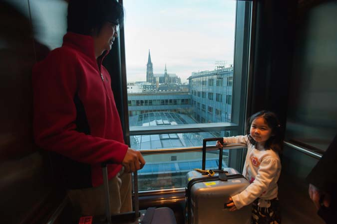 <b>Cologne, February 3, 2012, 9:00AM:</b> It is early Friday morning and the Orchestra is preparing to leave for Luxembourg. Satchi, the daughter of Philharmonic violinist Sharon Yamada, helps her father, Keisuke Ikuma (who is performing English horn on the tour), bring the family's luggage to the lobby. <br><br>  All photos by Chris Lee