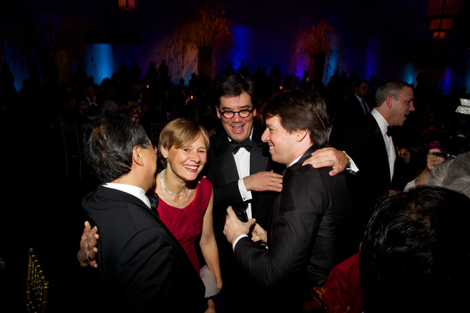 <b>9:43PM:</b> Musical quartet: Yo-Yo Ma shares a laugh with Alan Gilbert and his wife, cellist Kajsa William-Olsson, and violinist and Philharmonic Board Member Joshua Bell. Photo by Julie Skarratt.