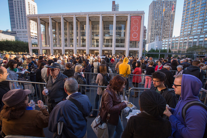 <b>7:54AM:</b> The line for the annual Free Dress Rehearsal — a gift from the New York Philharmonic and its Global Sponsor Credit Suisse to launch the Orchestra's 172nd season — of the Opening Gala Concert began forming at 4:50AM and now stretches across Lincoln Center's Josie Robertson Plaza. The first to arrive were Darial, attending for the third year, and her friend Marty, who grew up coming to the Philharmonic and is still a devoted Young People's Concerts subscriber. Photo by Chris Lee.