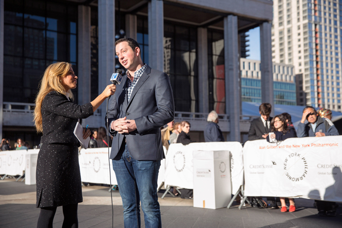 <b>8:16AM:</b> NY1 News' live coverage of the Plaza activities includes this interview with Philharmonic trumpet player Ethan Bensdorf. Photo by Chris Lee.