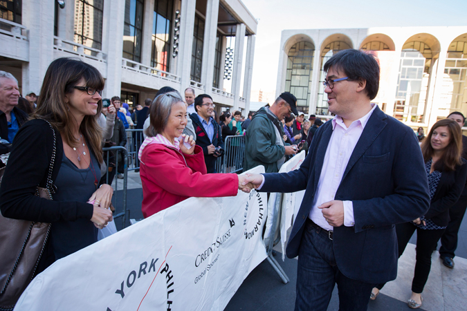 <b>8:51AM:</b> The man himself appears! Music Director Alan Gilbert has made it a custom to come to the Plaza to speak with those lined up to attend the Free Dress Rehearsal. Photo by Chris Lee.