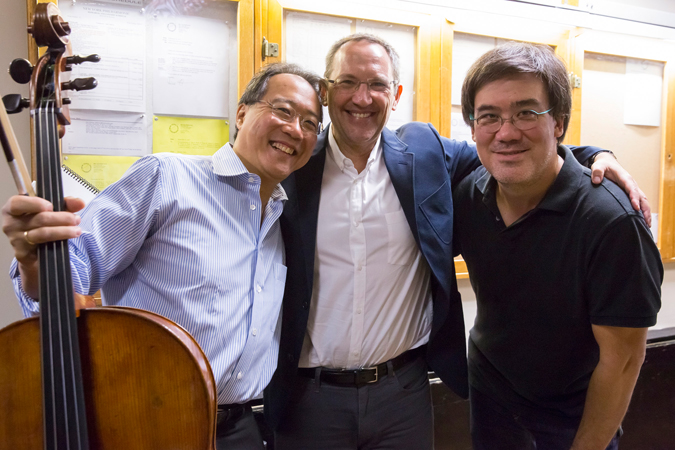 "<b>10:33AM:</b> The dream team: Yo-Yo Ma, Osvaldo Golijov, and Alan Gilbert take a moment backstage before beginning the rehearsal of Mr. Golijov's <em>Azul.</em> The Music Director has written: ""It is a dream to have Yo-Yo Ma opening our season.… Golijov is one of the most important composers working today, and I feel that this piece reflects the emotional kinship that these two great artists share."" Photo by Chris Lee."
