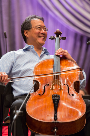 <b>11:07AM:</b> Yo-Yo Ma's enthusiasm shines from his trademark smile as he rehearses with the New York Philharmonic. Photo by Chris Lee.