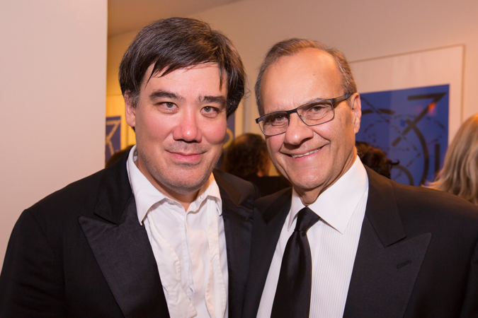 "<b>9:18PM:</b> After the concert, baseball legend and former Yankees manager Joe Torre congratulates Alan Gilbert on a hit. In July he joined Alan and the Philharmonic in Central Park for the Major League Baseball All-Star Charity Concert, when he narrated a musical setting of the classic poem ""Casey at the Bat."" Photo by Chris Lee."