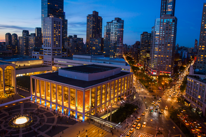 <b>7:09PM:</b> Seen from above, Avery Fisher Hall is aglow in Credit Suisse blue as the audience converges on Lincoln Center for the Philharmonic's Opening Gala Concert. Photo by Chris Lee.