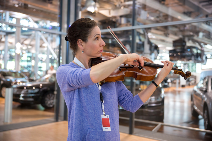 <b>Dresden, May 13, 2013, 10:50AM:</b> During a rehearsal break, Associate Principal Viola Rebecca Young checks out the Volkswagen Transparent Factory's acoustics.