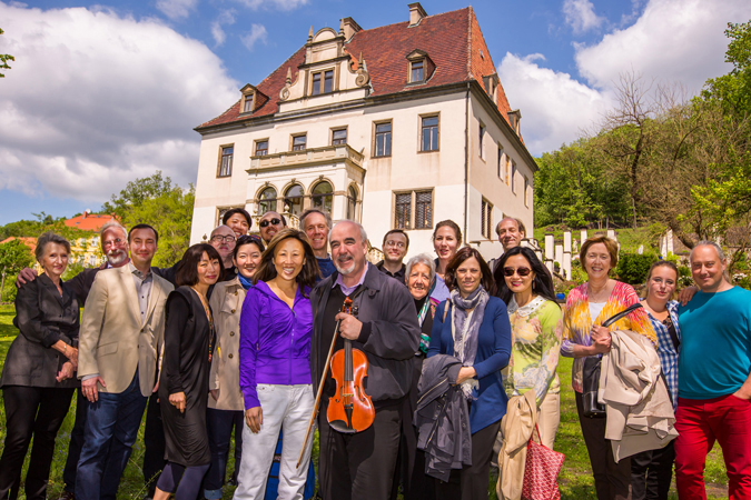 <b>Dresden, May 13, 2013, 2:20PM:</b> Associate Principal Cello Eileen Moon (front, in purple) and fellow Orchestra colleagues visit her cousin Kyungah Schmidt (fourth from left) and Kyungah's husband, Boris (third from left), at their home, Hohenhaus, built in 1373 in Dresden's Radebeul region.