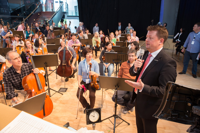<b>Dresden, May 14, 2013, 10:00AM:</b> Before rehearsal begins the next morning, Oliver Winkes, Volkswagen's head of sales and marketing, welcomes the Orchestra to the factory.