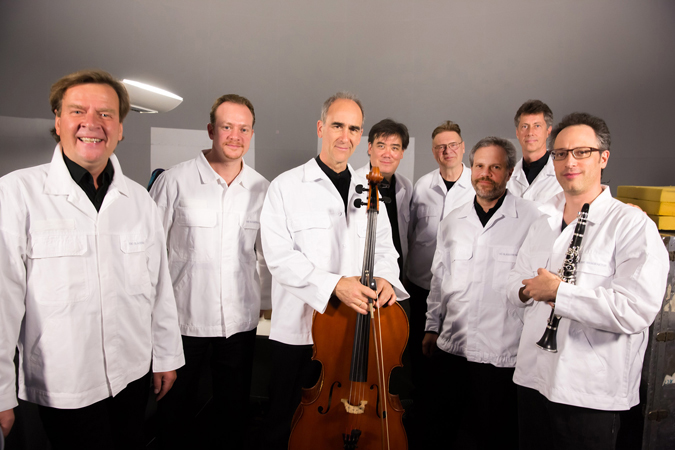 "<b>Dresden, May 14, 2013, 9:25PM:</b> Sporting their spiffy Volkswagen lab coats, <i>Kraft'</i>s ""mobile soloists,"" who must move about the space during the performance, join a similarly attired Alan Gilbert before taking the ""stage."" They are Magnus Lindberg (who is not only the composer, but a soloist on piano as well as an array of found objects), Principal Timpani Markus Rhoten, Principal Cello Carter Brey, Juhani Liimatainen on electronics, Associate Principal Percussion Daniel Druckman, Principal Percussion Christopher S. Lamb, and guest clarinetist Chen Halevi."