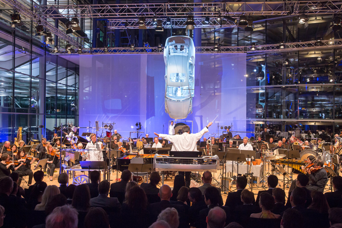 "<b>Dresden, May 14, 2013, 9:52PM:</b> Noise, power, and choreographed pandemonium at the Volkswagen Transparent Factory. ""<i>Kraft</i> is a peculiar piece in that it contains its own acoustics,"" composer and soloist Magnus Lindberg said. ""Here we have the luxury of using brand new car parts, many of them very heavy, strong steel, and producing exactly the kinds of sounds I need."""