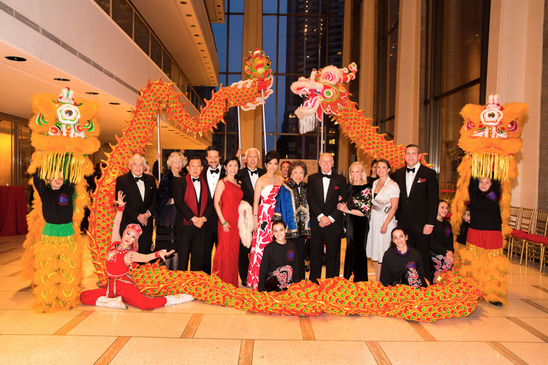<b>5:51PM:</b> The New York Philharmonic welcomed the Year of the Sheep at its fourth-annual Chinese New Year Concert and Gala, presented by the Starr International Foundation.  Before guests arrived at the pre-concert cocktail reception, those who made the Gala possible gathered with dragon dancers from the Nai-Ni Chen Dance Company: from left, Honorary Gala Chairmen James D. and Elaine Wolfensohn; Gala Co-Chairmen Guoqing Chen, Gary W. Parr, Agnes Hsu-Tang and Oscar L. Tang, Angela Chen, and Shirley Young; Philharmonic Board Chairman Oscar S. Schafer; Special Events Chairman Karen LeFrak; and Philharmonic President Matthew VanBesien and his wife, Rosie Jowitt. Not pictured are Honorary Gala Chairmen Mr. and Mrs. Maurice R. Greenberg, H.E. Ambassador Liu Jieyi, and H.E. Consul General Zhang Qiyue, and Gala Co-Chairman Ming Liu. Photo by Chris Lee.