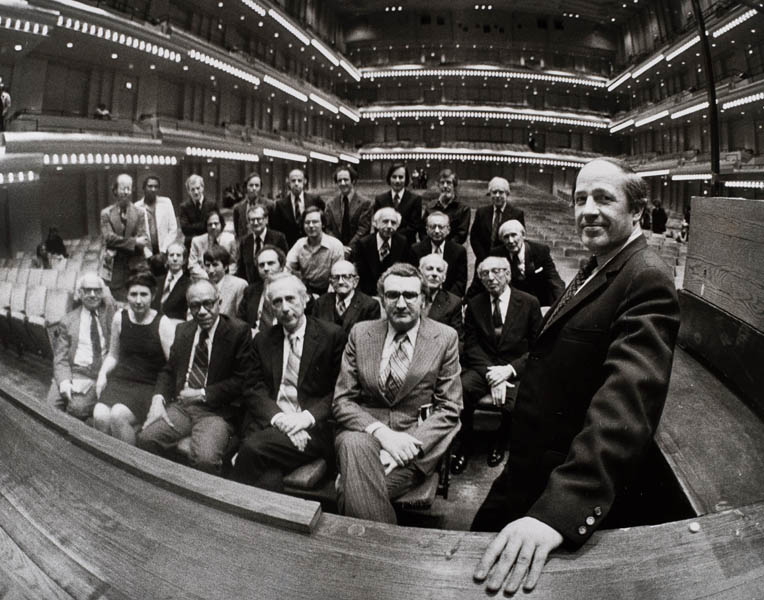 Among the American composers who gathered for Pierre Boulez's farewell performance as Music Director in 1977 were (back row, standing, from left) Charles Wuorinen, Carman Moore, Sidney Hodkinson, David Del Tredici, Earle Brown, Steve Reich, Stanley Silverman, John Cage, and Elliott Carter; (second to last row) Donald Martino, Donald Harris, Daniel Plante, Morton Gould, Vincent Persichetti, and Roy Harris; (third to last row) Assistant Conductor David Gilbert, Stephen Jablonski, Jacob Druckman, Roger Sessions, William Schuman, and Aaron Copland; and (front row) Milton Babbitt, Lucia Dlugoszewski, Ulysses Kay, George Rochberg, and Mario Davidovsky.