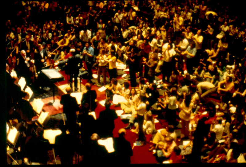 The other innovative concert series Boulez introduced as Music Director was the still-famous <em>Rug Concerts.</em> To eliminate a sense of formality, as well as a barrier between audience and performers, the chairs in the auditorium were removed and the audience sat on carpeting and cushions on the floor, as well as onstage. The Orchestra was divided into two groups — one consisting of 70 musicians, and the other of 35 — which performed on alternate nights, making it possible to present a greater variety of programs ranging from the Baroque to the avant-garde to show relationships between music composed over centuries.