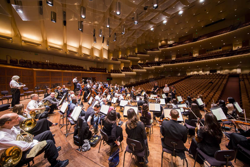 <b>San Francisco, Friday, May 6, 2016, 7:16PM:</b> When Music Director Alan Gilbert and the Philharmonic assemble for rehearsal, Orchestra Personnel Manager Carl R. Schiebler (front of stage) makes sure that all is in order as Concertmaster Frank Huang tunes the Orchestra.