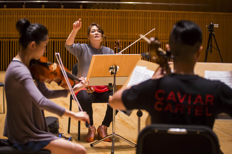 <b>Shanghai, July 7, 2016, 1:58PM:</b> Teaching is a major component of this residency. The Philharmonic musicians who act as Shanghai Orchestra Academy (SOA) instructors include Assistant Concertmaster Michelle Kim, who here coaches a chamber music ensemble of SOA students.