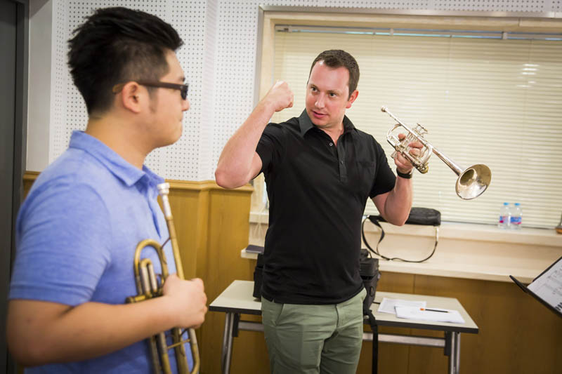 <b>Shanghai, July 7, 2016, 2:41PM:</b> Acting Associate Principal Trumpet Ethan Bensdorf encourages this SOA student.