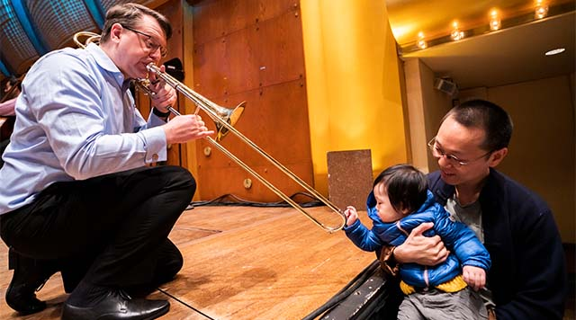 Philharmonic Associate Principal Trombone Colin Williams was one of the musicians who welcomed kids and their families to Fun at the Phil: Sleepover at the Museum before the concert began. Photo by Chris Lee.
