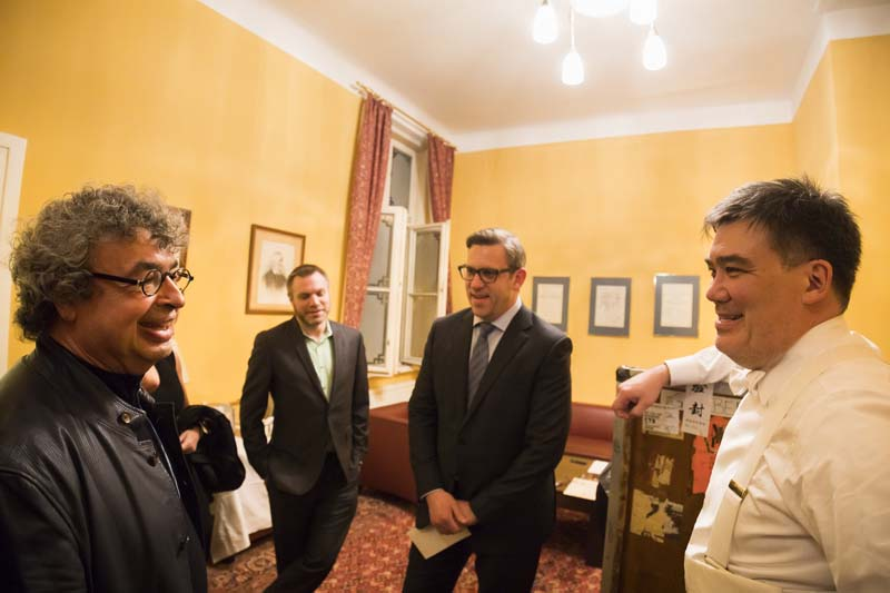 <b>Vienna, March 29, 2017, 7:16PM:</b> It's the next day and the itinerant musicians have arrived in Vienna. Backstage before the concert, beloved friend Semyon Bychkov (left) visits Alan Gilbert, President Matthew VanBesien (second from right), and Assistant Conductor Joshua Gersen. It's a reunion of sorts: in January and February, Bychkov, who is in town to conduct at the Vienna Staatsoper, presided over <em>Beloved Friend — Tchaikovsky and His World:</em> A Philharmonic Festival. Photo by Chris Lee.
