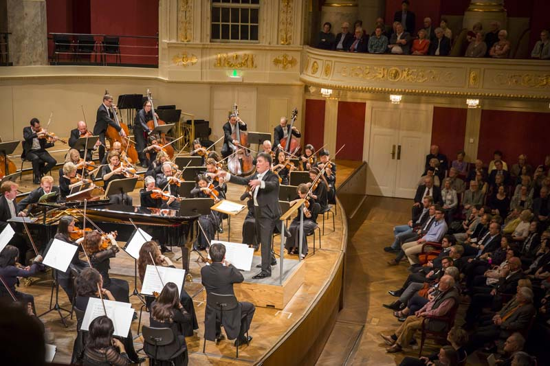 <b>Vienna, March 29, 2017, 8:04PM:</b> Alan Gilbert conducts Bartók's virtuosic Music for Strings, Percussion, and Celesta, for which the composer directed that the strings be divided into two groups staged opposite each other. Photo by Chris Lee.