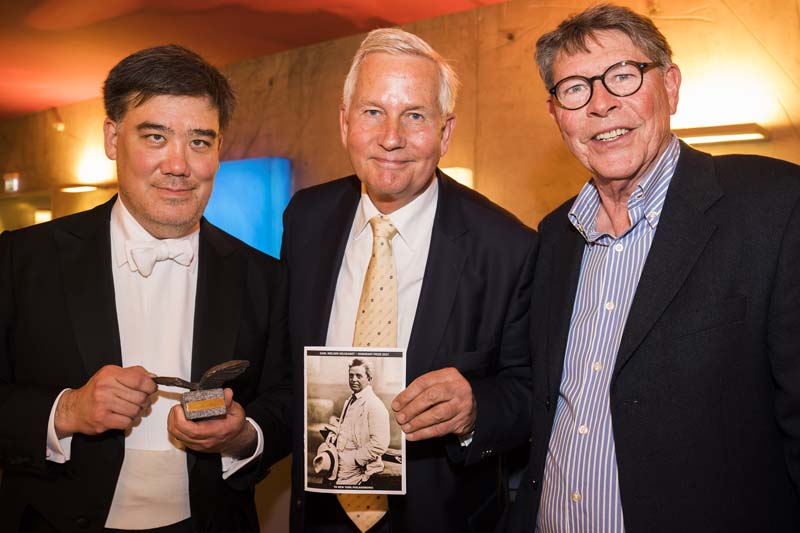<b>Copenhagen, April 7, 2017, 8:08PM:</b> The busy intermission includes the presentation of an honor. Before Alan Gilbert returns to the stage, representatives of the Carl Nielsen Society, including Morten Riise-Knudsen (center), bestow on him and the Orchestra its Honorary Prize, given annually to musicians or scholars who have notably advanced the understanding and appreciation of the great Danish composer, who was a focus of Mr. Gilbert's Philharmonic tenure.